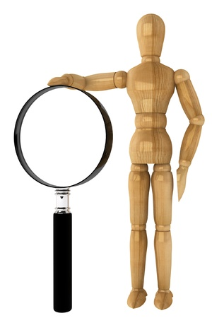 Wooden dummy with magnifying glass on a white background photo