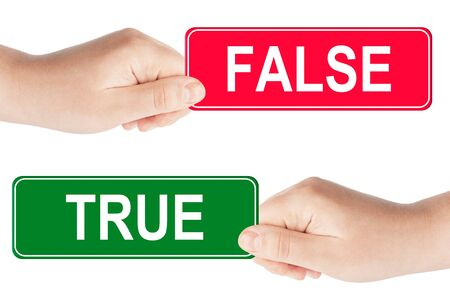 True and False traffic sign in the hand on the white background photo