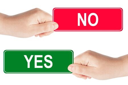 yes no: Yes and No traffic sign in the hand on the white background Stock Photo