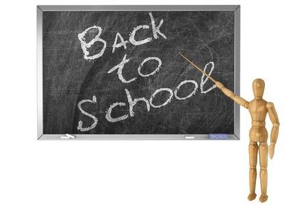 Back to school sign handwritten with wooden dummy chalk on a school blackboard photo
