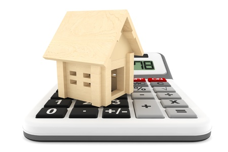 economic rent: Wooden House with Calculatoron a white background  Stock Photo