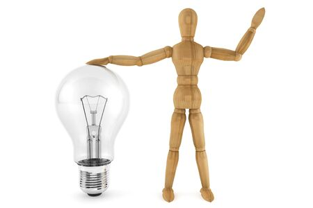 Wooden mannequin with light bulb on a white background  photo