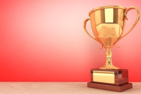 チャンピオンのゴールド カップ トロフィー赤の背景 写真素材
