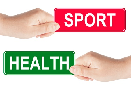 Sport and Health traffic sign in the hand on the white background photo