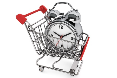 Shopping Cart with Alarm Clock on a white background photo