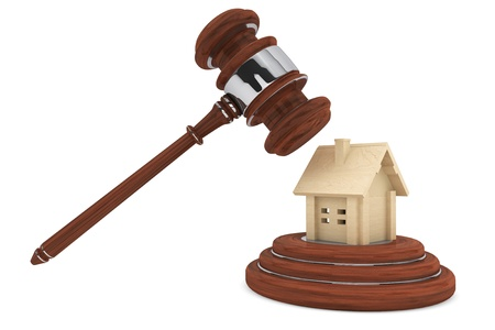 Justice Gavel with wooden House on a white background photo