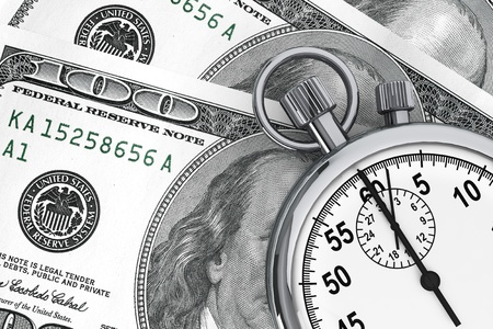 financial metaphor: El tiempo es dinero concepto. Cien d�lares y un cron�metro sobre un fondo blanco