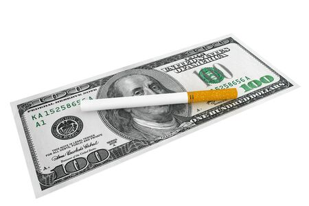 habit: Expensive habit and No Smoking concept. Dollars banknotes with cigarette on a white background