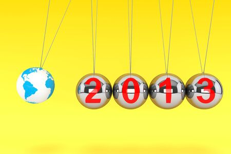 New Year concept. Spheres of Newton with Globe Earth and 2013 sign on a yellow background photo