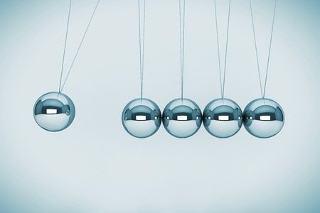 business continuity: Perpetual motion concept. Spheres of Newton on a white background Stock Photo