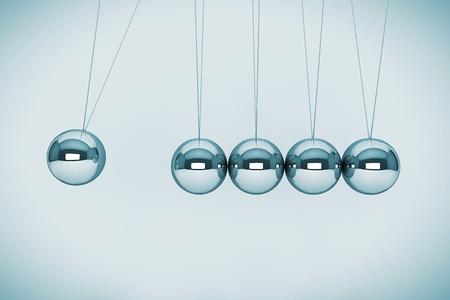 Perpetual motion concept. Spheres of Newton on a white background 版權商用圖片