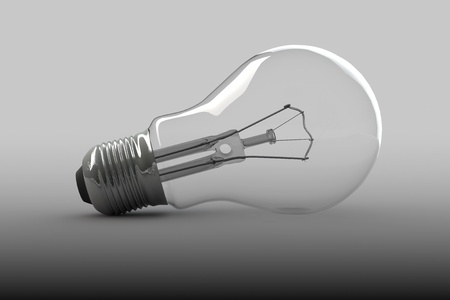 Closeup Light Bulb on a grey background photo