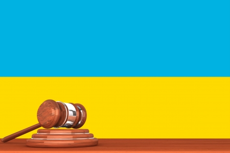 Wooden Justice Gavel with Flag Of Ukraine photo