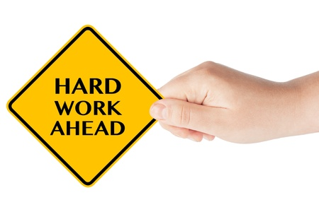 hard work ahead: Hard Work Ahead traffic sign in womans hand on a white background Stock Photo