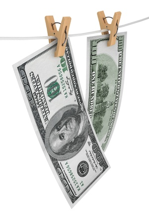 One hundred dollar bills is hanging on a rope with wooden clothespins on a white background Stock Photo - 17632615