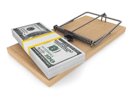 sudden: Money in a mousetrap on a white background