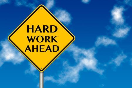 hard work ahead: Hard Work Ahead traffic sign on a sky background Stock Photo