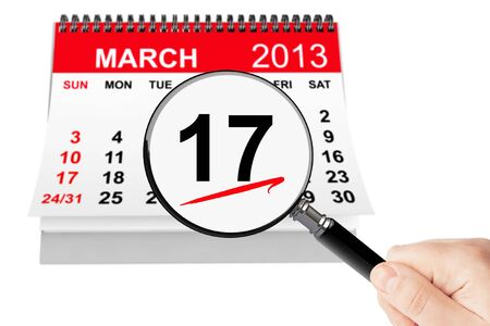 march 17: St. Patrick Day Concept. 17 march calendar with magnifier on a white background