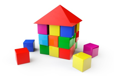 House from children cubes on a white background photo