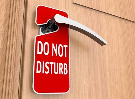 rest in peace: Do not disturb sign on a hotel door handle