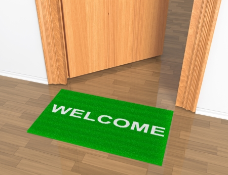 Opened door with welcome rug on the floor photo