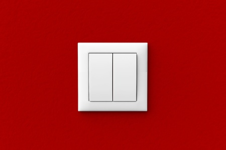 clean off: Modern light switch on a red wall Stock Photo