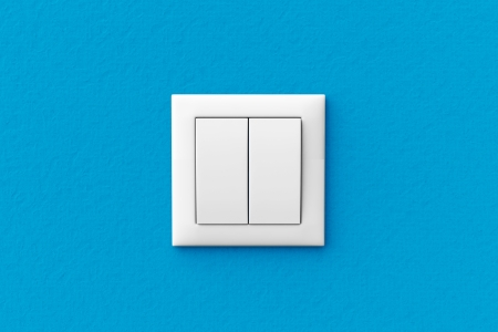 Modern light switch on a blue wall photo