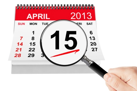 Tax Day Concept. 15 april 2013 calendar with magnifier on a white background photo