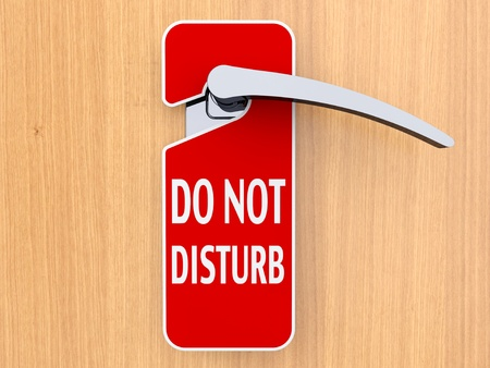 do not disturb: Do not disturb sign hanging on door in a hotel