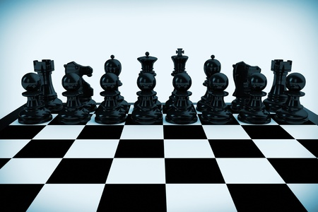 Chess board set up to begin a game in blue key photo