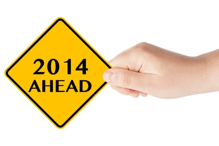 cautionary: 2014 year Ahead traffic sign in womans hand on a white background Stock Photo