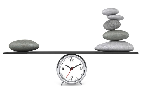 Zen Stones balanced on a clock over white background photo