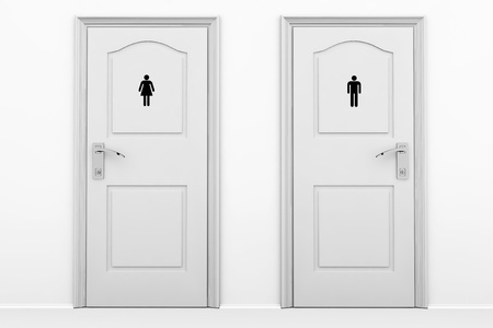 Toilet doors for male and female genders in grey key 版權商用圖片