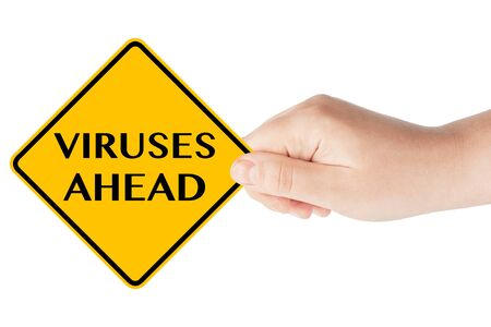 Viruses Ahead traffic sign in woman's hand on a white background photo