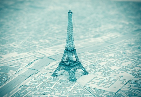 Eiffel Tower on the map of Paris extreme closeup photo