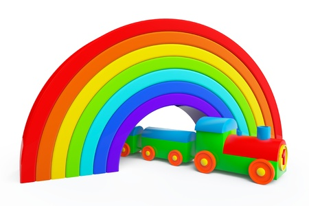 Toy multicolor train under rainbow bridge on a white background photo