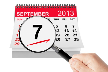 Salami Day Concept. 7 september 2013 calendar with magnifier on a white background photo