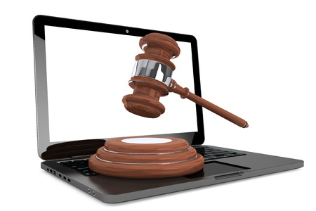 pirated: Cyber Law Concept. Moder Laptop with wooden gavel on a white background