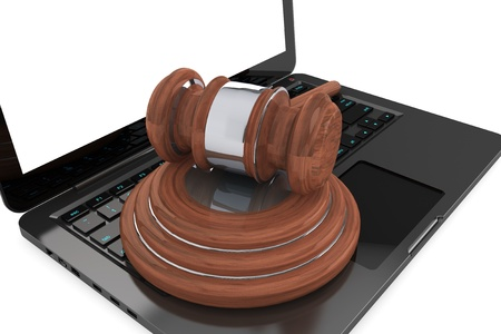 Cyber Law Concept. Moder Laptop with wooden gavel on a white background photo
