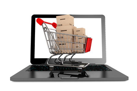 Online shopping concept. Shopping Cart with Boxes over Laptop on a white background 版權商用圖片