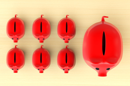 Growing investment concept. Red Piggy Banks in row on a wooden table photo
