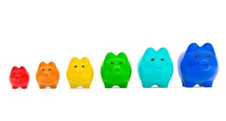 Growing investment concept. Colour Piggy Banks in row on a white background photo