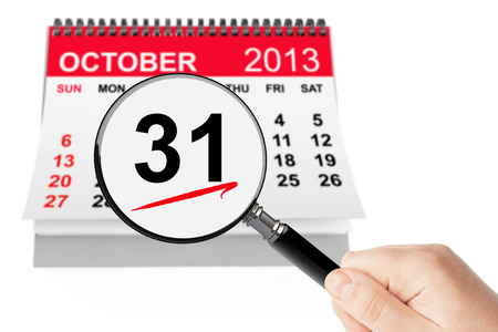 Halloween Day Concept. 31 october 2013 calendar with magnifier on a white background photo