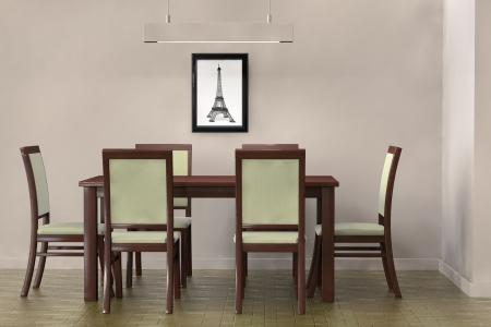 リビング ルームの設定です。空白の壁に直面する現代のテーブルと椅子