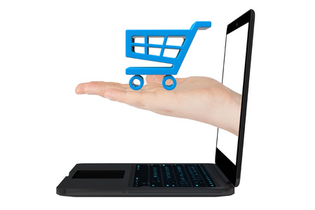 Online shopping concept. Shopping Cart Icon in hand with Laptop on a white background photo