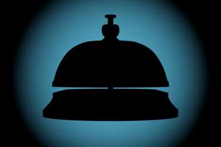 Service Bell silhouette on a wall with blue backlight photo