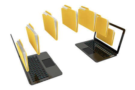 Two laptop computers with folders transferring between each other on a white background Stock Photo