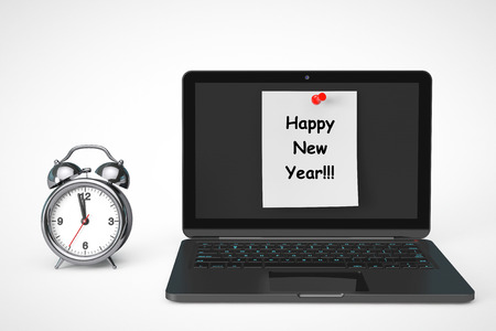 Alarm Clock with Laptop computer and Happy New Year sign on a white background photo