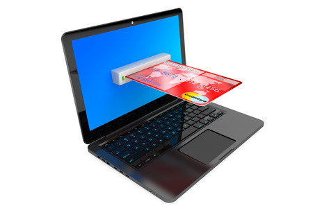E-commerce Concept. Laptop computer and Credit Card on a white background photo