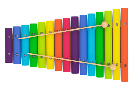 Colorful wooden xylophone with mallets on a white background photo